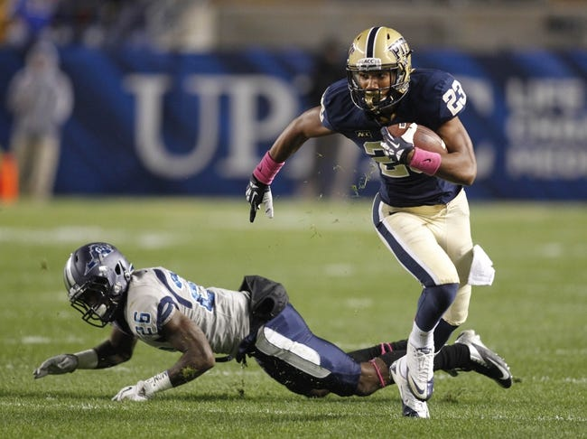 Oct 19, 2013; Pittsburgh, PA, USA; Pittsburgh Panthers wide receiver Tyler Boyd (23) runs the ball after a pass reception past Old Dominion Monarchs cornerback Eriq Lewis (26) during the second quarter at Heinz Field. Pittsburgh won 35-24. Mandatory Credit: Charles LeClaire-USA TODAY Sports
