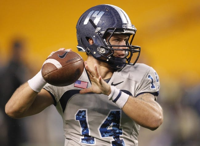 Oct 19, 2013; Pittsburgh, PA, USA; Old Dominion Monarchs quarterback Taylor Heinicke (14) throws a pass during the pre-game before facing the Pittsburgh Panthers at Heinz Field. Pittsburgh won 35-24.Mandatory Credit: Charles LeClaire-USA TODAY Sports