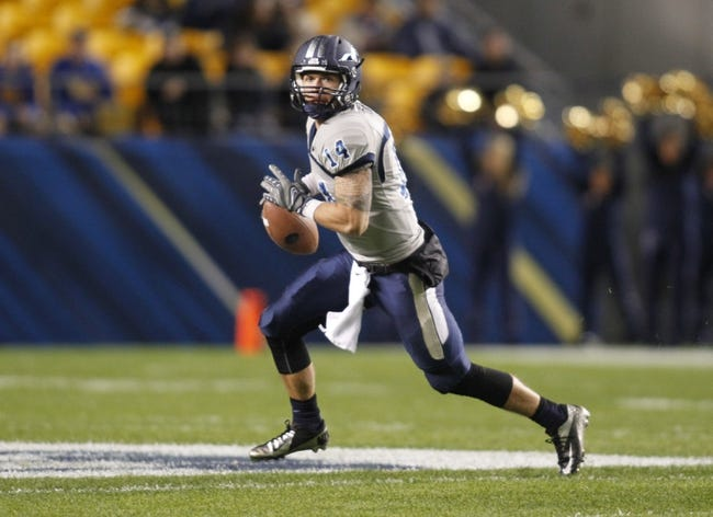 Oct 19, 2013; Pittsburgh, PA, USA; Old Dominion Monarchs quarterback Taylor Heinicke (14) scrambles with the ball against the Pittsburgh Panthers during the first quarter at Heinz Field. Pittsburgh won 35-24. Mandatory Credit: Charles LeClaire-USA TODAY Sports