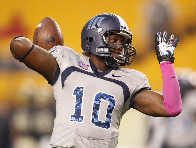 Oct 19, 2013; Pittsburgh, PA, USA; Old Dominion Monarchs quarterback David Washington (10) throws a pass during the pre-game before facing the Pittsburgh Panthers at Heinz Field. Pittsburgh won 35-24.Mandatory Credit: Charles LeClaire-USA TODAY Sports