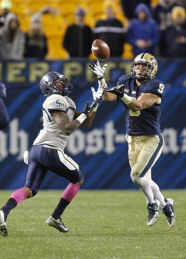 Oct 19, 2013; Pittsburgh, PA, USA; Old Dominion Monarchs wide receiver Antonio Vaughan (5) and Pittsburgh Panthers defensive back Ray Vinopal (9) makes a play on a ball during the fourth quarter at Heinz Field.  Pittsburgh won 35-24. Mandatory Credit: Charles LeClaire-USA TODAY Sports