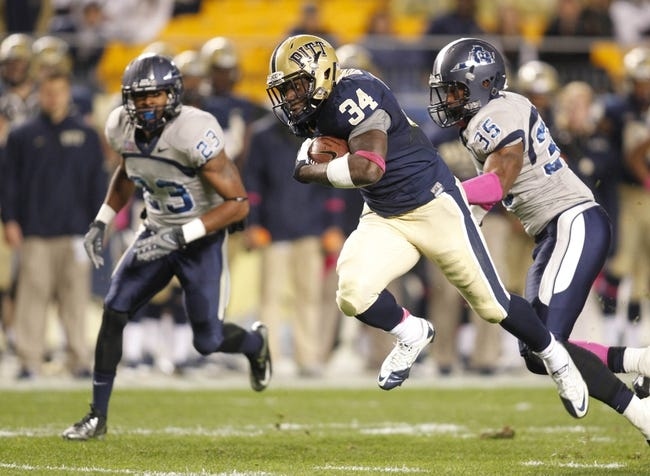 Oct 19, 2013; Pittsburgh, PA, USA; Pittsburgh Panthers running back Isaac Bennett (34) runs and scores a twenty-five yard touchdown against the Old Dominion Monarchs during the second quarter at Heinz Field. Pittsburgh won 35-24. Mandatory Credit: Charles LeClaire-USA TODAY Sports