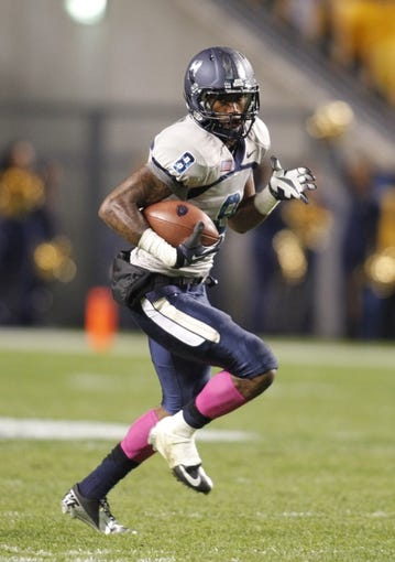 Oct 19, 2013; Pittsburgh, PA, USA; Old Dominion Monarchs wide receiver Blair Roberts (8) runs after a pass reception against the Pittsburgh Panthers during the third quarter at Heinz Field.  Pittsburgh won 35-24. Mandatory Credit: Charles LeClaire-USA TODAY Sports