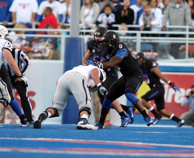 Oct 19, 2013; Boise, ID, USA; Boise State Broncos defensive end Demarcus Lawrence (8) during the game against the Nevada Wolf Pack at Bronco Stadium. Mandatory Credit: Brian Losness-USA TODAY Sports