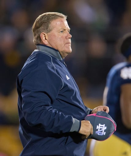Oct 19, 2013; South Bend, IN, USA; Notre Dame Fighting Irish head coach Brian Kelly watches warmups before the game against the USC Trojans at Notre Dame Stadium. Notre Dame won 14-10. Mandatory Credit: Matt Cashore-USA TODAY Sports