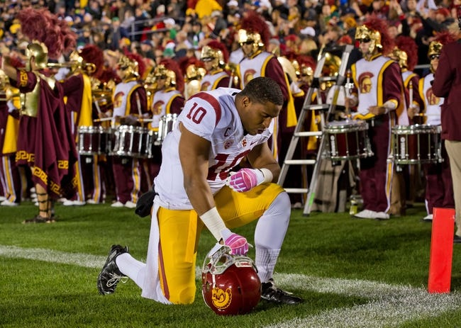 Oct 19, 2013; South Bend, IN, USA; USC Trojans linebacker Hayes Pullard (10) kneels before the game against the Notre Dame Fighting Irish at Notre Dame Stadium. Notre Dame won 14-10. Mandatory Credit: Matt Cashore-USA TODAY Sports