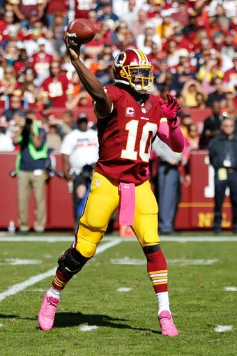 Oct 20, 2013; Landover, MD, USA; Washington Redskins quarterback Robert Griffin III (10) throws the ball against the Chicago Bears at FedEx Field. Mandatory Credit: Geoff Burke-USA TODAY Sports