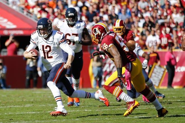 Oct 20, 2013; Landover, MD, USA; Chicago Bears quarterback Josh McCown (12) runs with the ball against the Washington Redskins at FedEx Field. Mandatory Credit: Geoff Burke-USA TODAY Sports