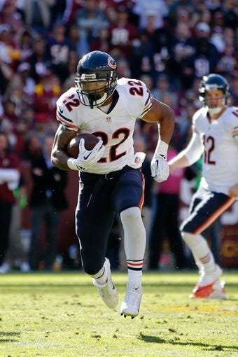 Oct 20, 2013; Landover, MD, USA; Chicago Bears running back Matt Forte (22) carries the ball against the Washington Redskins at FedEx Field. Mandatory Credit: Geoff Burke-USA TODAY Sports