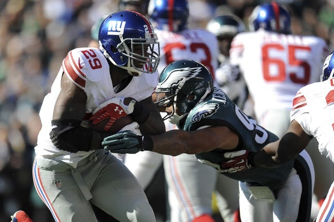 Oct 27, 2013; Philadelphia, PA, USA; New York Giants running back Michael Cox (29) runs the ball against the Philadelphia Eagles during the first half at Lincoln Financial Field. The Giants won the game 15-7. Mandatory Credit: Joe Camporeale-USA TODAY Sports