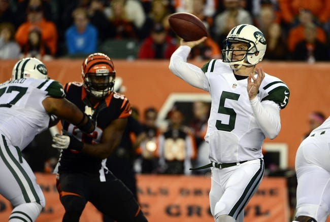 Oct 27, 2013; Cincinnati, OH, USA; New York Jets quarterback Matt Simms (5) throws a pass during the second half of the game at Paul Brown Stadium. Mandatory Credit: Marc Lebryk-USA TODAY Sports