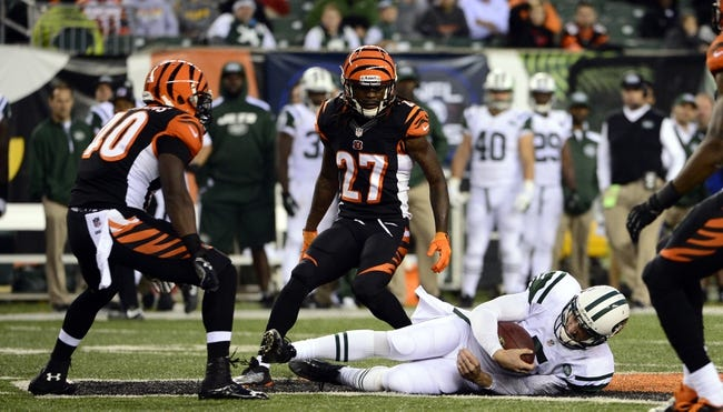 Oct 27, 2013; Cincinnati, OH, USA; New York Jets quarterback Matt Simms (5) slides to avoid being tackled after a run during the second half of the game at Paul Brown Stadium. Mandatory Credit: Marc Lebryk-USA TODAY Sports