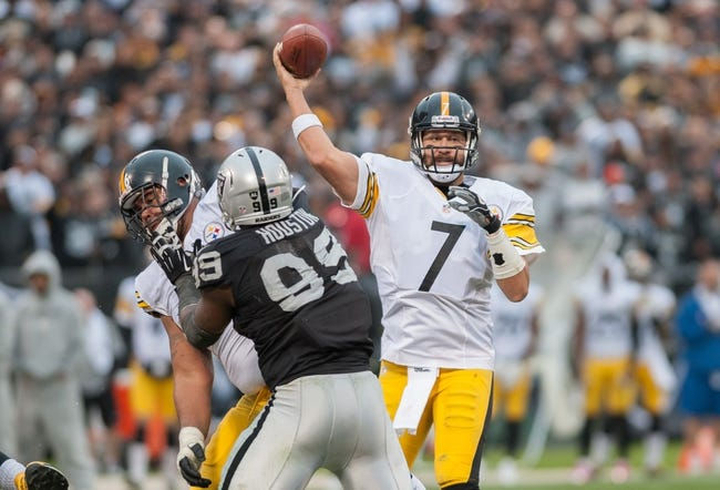 Oct 27, 2013; Oakland, CA, USA; Pittsburgh Steelers quarterback Ben Roethlisberger (7) throws a pass against the Oakland Raiders during the fourth quarter at O.co Coliseum. The Oakland Raiders defeated the Pittsburgh Steelers 21-18. Mandatory Credit: Ed Szczepanski-USA TODAY Sports