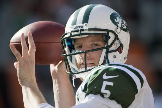 Oct 27, 2013; Cincinnati, OH, USA; New York Jets quarterback Matt Simms (5) throws a ball to a fan on the sidelines before the game at Paul Brown Stadium. Mandatory Credit: Marc Lebryk-USA TODAY Sports