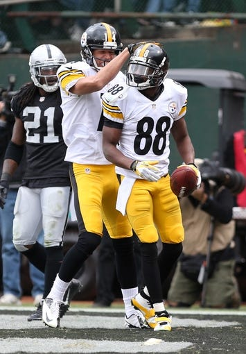 Oct 27, 2013; Oakland, CA, USA; Pittsburgh Steelers wide receiver Emmanuel Sanders (88) celebrates with wide receiver Derek Moye (14) after scoring a touchdown against the Oakland Raiders during the fourth quarter at O.co Coliseum. The Oakland Raiders defeated the Pittsburgh Steelers 21-18. Mandatory Credit: Kelley L Cox-USA TODAY Sports