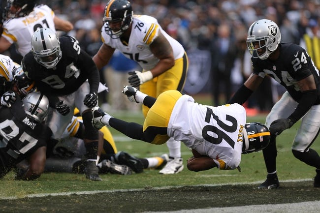 Oct 27, 2013; Oakland, CA, USA; Pittsburgh Steelers running back Le'Veon Bell (26) scores a touchdown against the Oakland Raiders during the fourth quarter at O.co Coliseum. The Oakland Raiders defeated the Pittsburgh Steelers 21-18. Mandatory Credit: Kelley L Cox-USA TODAY Sports