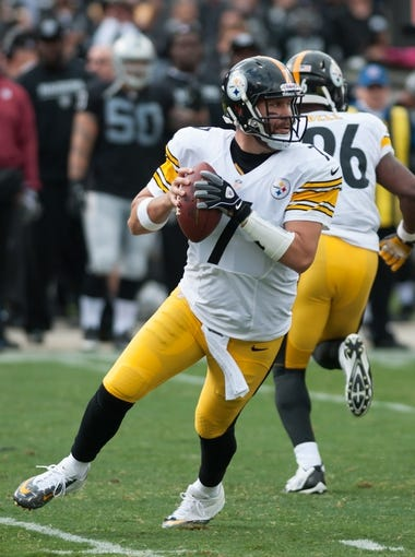 Oct 27, 2013; Oakland, CA, USA; Pittsburgh Steelers quarterback Ben Roethlisberger (7) rolls out of the pocket during the first quarter of the game against the Oakland Raiders at O.co Coliseum. The Oakland Raiders defeated the Pittsburgh Steelers 21-18. Mandatory Credit: Ed Szczepanski-USA TODAY Sports