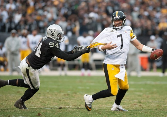 Oct 27, 2013; Oakland, CA, USA; Pittsburgh Steelers quarterback Ben Roethlisberger (7) attempts to escape from the grasp of Oakland Raiders outside linebacker Kevin Burnett (94) during the fourth quarter at O.co Coliseum. The Oakland Raiders defeated the Pittsburgh Steelers 21-18. Mandatory Credit: Ed Szczepanski-USA TODAY Sports