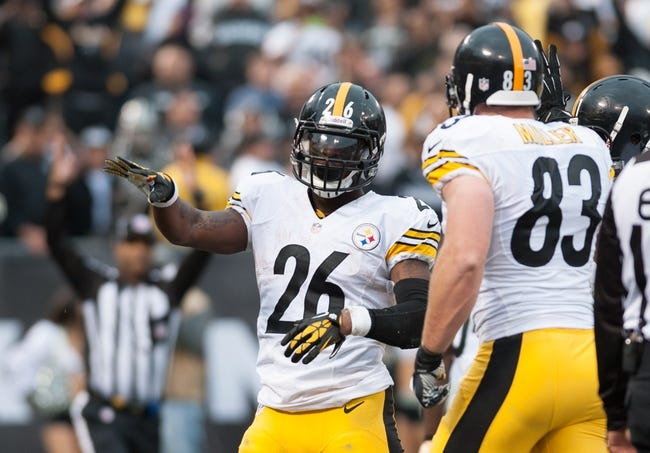 Oct 27, 2013; Oakland, CA, USA; Pittsburgh Steelers running back Le'Veon Bell (26) celebrates after scoring a touchdown against the Oakland Raiders during the fourth quarter at O.co Coliseum. The Oakland Raiders defeated the Pittsburgh Steelers 21-18. Mandatory Credit: Ed Szczepanski-USA TODAY Sports