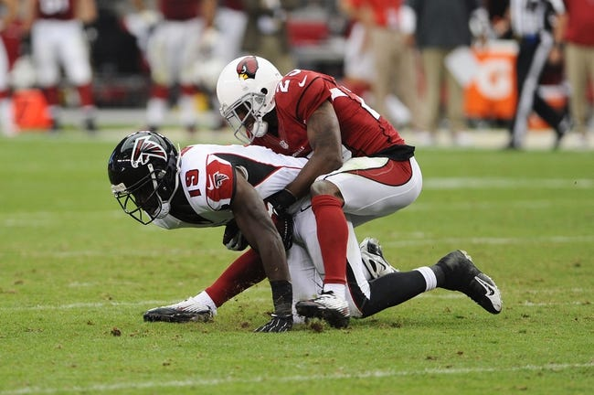 Oct 27, 2013; Phoenix, AZ, USA; Atlanta Falcons wide receiver Drew Davis (19) is tackled by Arizona Cardinals cornerback Jerraud Powers (25) in the second half at University of Phoenix Stadium. The Cardinals defeated the Falcons 27-13. Mandatory Credit: Jennifer Stewart-USA TODAY Sports