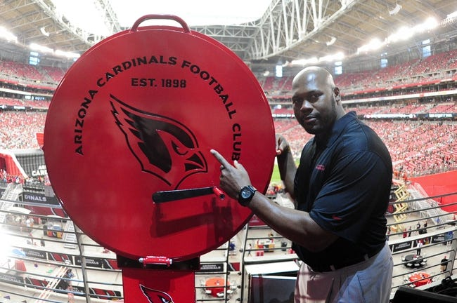 Oct 27, 2013; Phoenix, AZ, USA; Former Arizona Cardinals Bertrand Berry poses with the Big Red Siren prior to the game against the Atlanta Falcons at University of Phoenix Stadium. Mandatory Credit: Matt Kartozian-USA TODAY Sports