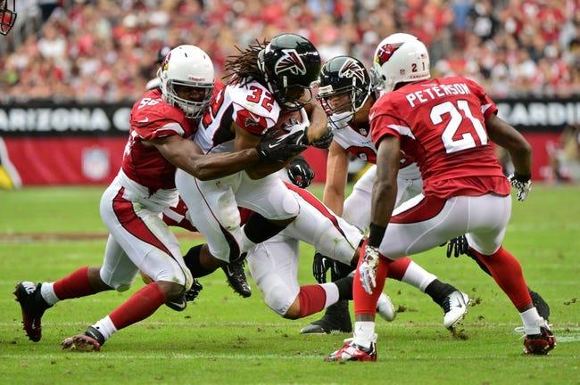 Oct 27, 2013; Phoenix, AZ, USA; Arizona Cardinals inside linebacker Karlos Dansby (56) tackles Atlanta Falcons running back Jacquizz Rodgers (32) during the first half at University of Phoenix Stadium. Mandatory Credit: Matt Kartozian-USA TODAY Sports