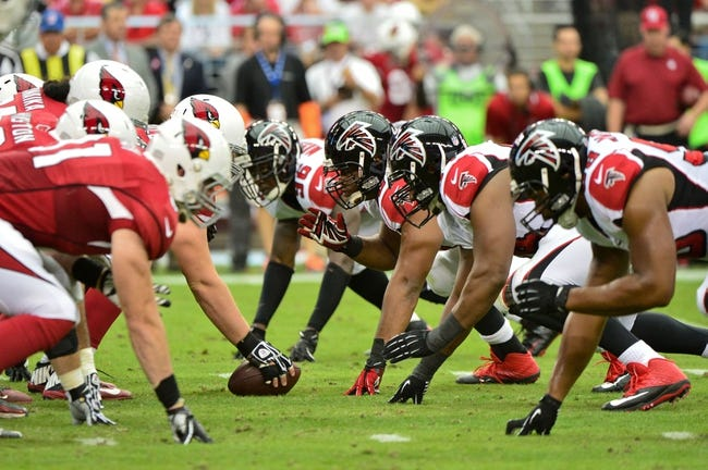 Oct 27, 2013; Phoenix, AZ, USA; The Atlanta Falcons defensive line squares off against the Arizona Cardinals offensive line during the first half at University of Phoenix Stadium. Mandatory Credit: Matt Kartozian-USA TODAY Sports