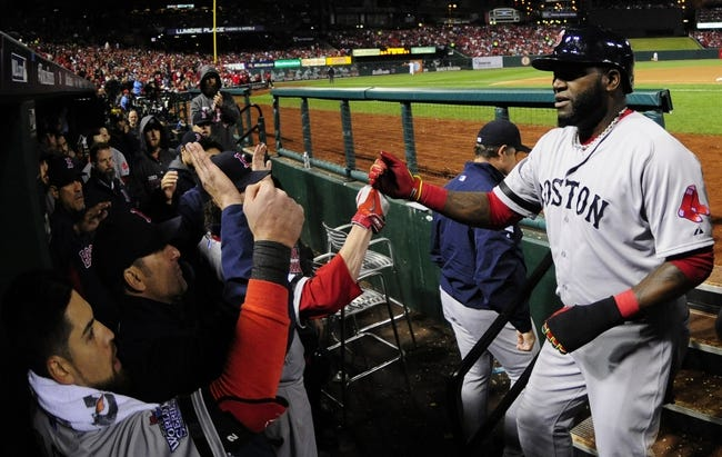 Oct 27, 2013; St. Louis, MO, USA; Boston Red Sox designated hitter David Ortiz is welcomed back to the dugout after scoring a run against the St. Louis Cardinals in the fifth inning during game four of the MLB baseball World Series at Busch Stadium. Mandatory Credit: Jeff Curry-USA TODAY Sports