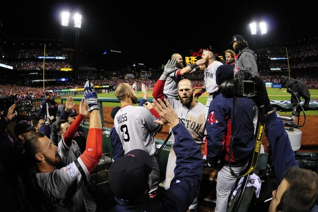 Oct 27, 2013; St. Louis, MO, USA; Boston Red Sox second baseman Dustin Pedroia (middle) and left fielder Jonny Gomes (top) are welcomed back to the dugout after a three-run home run by Gomes in the 6th inning during game four of the MLB baseball World Series against the St. Louis Cardinals at Busch Stadium. Mandatory Credit: Jeff Curry-USA TODAY Sports