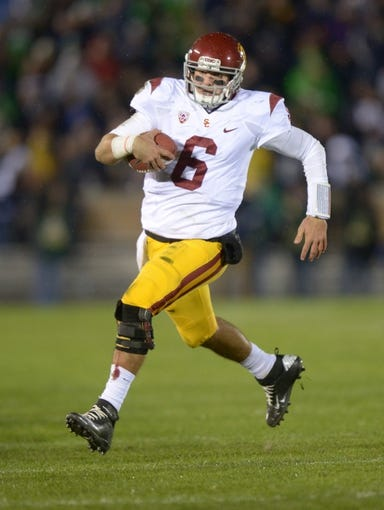 Oct 19, 2013; South Bend, IN, USA; Southern California Trojans quarterback Cody Kessler (6) scrambles against the Notre Dame Fighting Irish at Notre Dame Stadium. Notre Dame defeated USC 14-10. Mandatory Credit: Kirby Lee-USA TODAY Sports