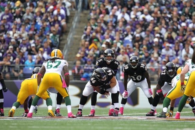 Oct 13, 2013; Baltimore, MD, USA; Baltimore Ravens quarterback Joe Flacco (5) stands behind center against the Green Bay Packers at M&T Bank Stadium. Mandatory Credit: Mitch Stringer-USA TODAY Sports