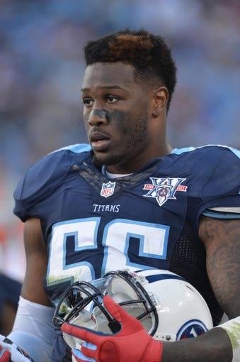 Oct 20, 2013; Nashville, TN, USA; Tennessee Titans linebacker Akeem Ayers (56) stands in the Titans bench area in a game against the San Francisco 49ers during the second half at LP Field. The 49ers beat the Titans 31-17. Mandatory Credit: Don McPeak-USA TODAY Sports