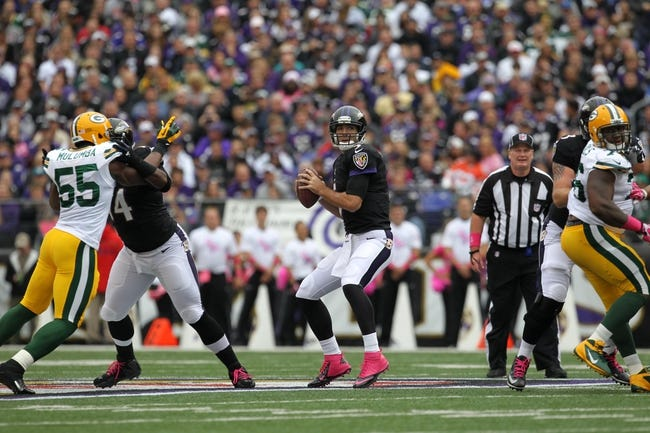 Oct 13, 2013; Baltimore, MD, USA; Baltimore Ravens quarterback Joe Flacco (5) drops back to pass against the Green Bay Packers at M&T Bank Stadium. Mandatory Credit: Mitch Stringer-USA TODAY Sports