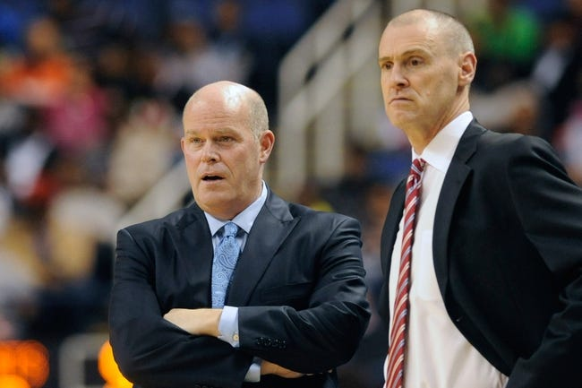 Oct 19, 2013; Greensboro, NC, USA; Charlotte Bobcats head coach Steve Clifford and Dallas Mavericks head coach Rick Carlisle talk in a referee time out during the game at the Greensboro Coliseum. Mavericks win 89-83. Mandatory Credit: Sam Sharpe-USA TODAY Sports