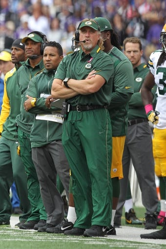 Oct 13, 2013; Baltimore, MD, USA; Green Bay Packers coach Kevin Greene the sidelines of the game against the Baltimore Ravens at M&T Bank Stadium. Mandatory Credit: Mitch Stringer-USA TODAY Sports