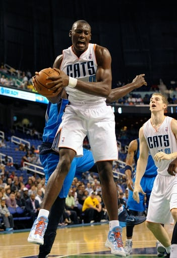 Oct 19, 2013; Greensboro, NC, USA; Charlotte Bobcats forward center Bismack Biyombo (0) gets a rebound during the game against the Dallas Mavericks at the Greensboro Coliseum. Mavericks win 89-83. Mandatory Credit: Sam Sharpe-USA TODAY Sports