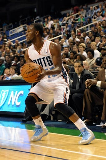 Oct 19, 2013; Greensboro, NC, USA; Charlotte Bobcats guard Kemba Walker (15) looks to pass during the game against the Dallas Mavericks at the Greensboro Coliseum. Mavericks win 89-83. Mandatory Credit: Sam Sharpe-USA TODAY Sports