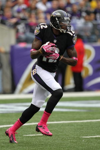 Oct 13, 2013; Baltimore, MD, USA; Baltimore Ravens kick returner Jacoby Jones (12) in action during the game against the Green Bay Packers at M&T Bank Stadium. Mandatory Credit: Mitch Stringer-USA TODAY Sports