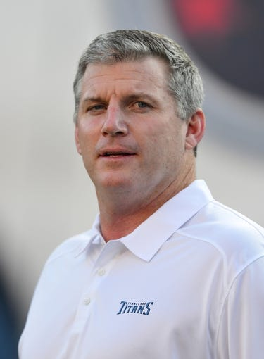 Aug 24, 2013; Nashville, TN, USA; Tennessee Titans head coach Mike Munchak watches his team warm up before a game against the  Atlanta Falcons at LP Field. The Titans beat the Falcons 27-16. Mandatory Credit: Don McPeak-USA TODAY Sports