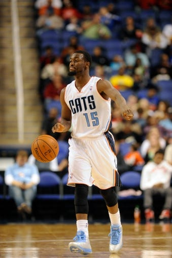 Oct 19, 2013; Greensboro, NC, USA; Charlotte Bobcats guard Kemba Walker (15) signals to his team during the game against the Dallas Mavericks at the Greensboro Coliseum. Mavericks win 89-83. Mandatory Credit: Sam Sharpe-USA TODAY Sports