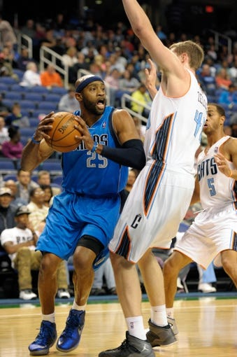 Oct 19, 2013; Greensboro, NC, USA; Dallas Mavericks guard Vince Carter (25) drives under the defense of Charlotte Bobcats forward Cody Zeller (40) during the game at the Greensboro Coliseum. Mavericks win 89-83. Mandatory Credit: Sam Sharpe-USA TODAY Sports