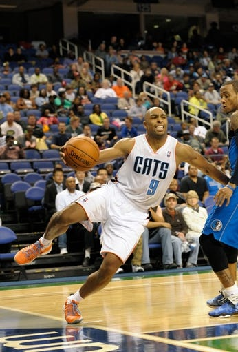 Oct 19, 2013; Greensboro, NC, USA; Charlotte Bobcats guard Gerald Henderson (9) tries to keep the ball inbounds during the game against the Dallas Mavericks at the Greensboro Coliseum. Mavericks win 89-83. Mandatory Credit: Sam Sharpe-USA TODAY Sports