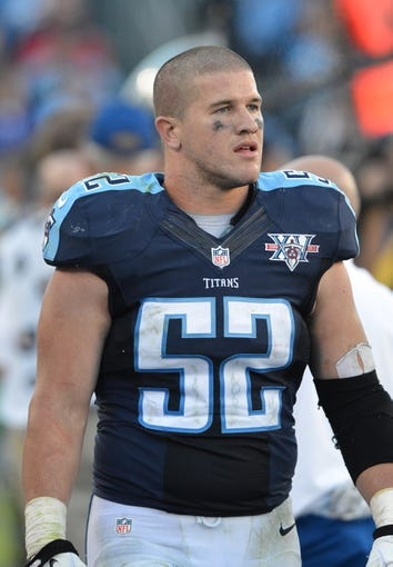 Oct 20, 2013; Nashville, TN, USA; Tennessee Titans linebacker Colin McCarthy (52) walks in the Titans bench area in a game against the San Francisco 49ers during the second half at LP Field. The 49ers beat the Titans 31-17. Mandatory Credit: Don McPeak-USA TODAY Sports