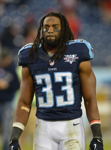 Oct 20, 2013; Nashville, TN, USA; Tennessee Titans safety Michael Griffin (33) exits the field after a game against the San Francisco 49ers at LP Field. The 49ers beat the Titans 31-17. Mandatory Credit: Don McPeak-USA TODAY Sports