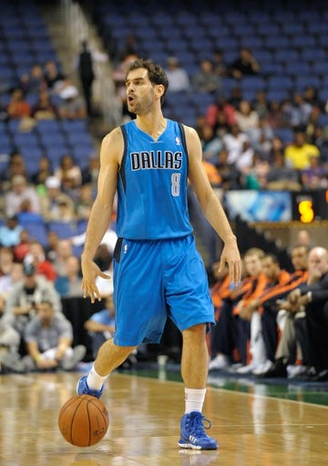 Oct 19, 2013; Greensboro, NC, USA; Dallas Mavericks guard Jose Calderon (8) prepares to drive down court during the game against the Charlotte Bobcats at the Greensboro Coliseum. Mavericks win 89-83. Mandatory Credit: Sam Sharpe-USA TODAY Sports