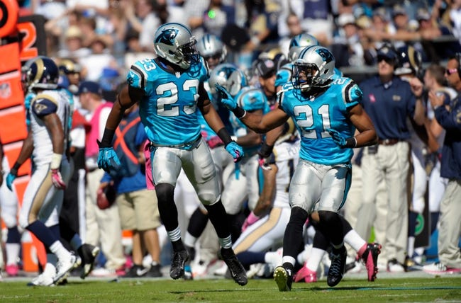 Oct 20, 2013; Charlotte, NC, USA; Carolina Panthers cornerback Melvin White (23) and safety Mike Mitchell (21)  during the game against the St. Louis Rams at Bank of America Stadium. Panthers win 30-15. Mandatory Credit: Sam Sharpe-USA TODAY Sports