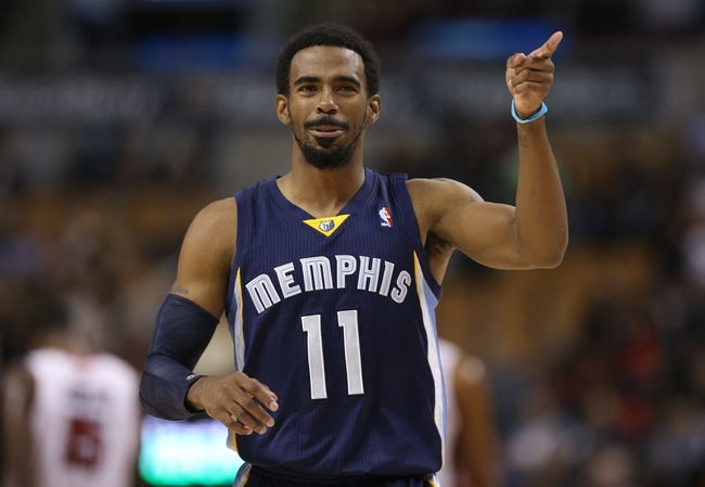 Oct 23, 2013; Toronto, Ontario, CAN; Memphis Grizzlies point guard Mike Conley (11) reacts against the Toronto Raptors at Air Canada Centre. The Raptors beat the Grizzlies 108-72. Mandatory Credit: Tom Szczerbowski-USA TODAY Sports