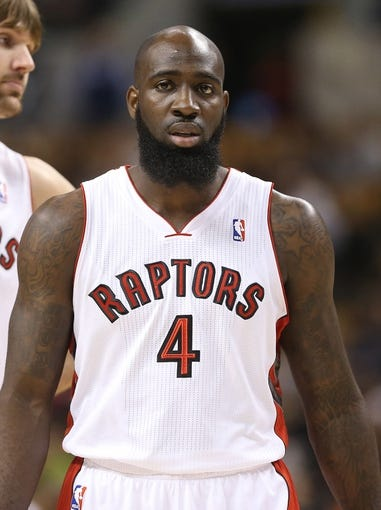 Oct 23, 2013; Toronto, Ontario, CAN; Toronto Raptors forward Quincy Acy (4) against the Memphis Grizzlies at Air Canada Centre. The Raptors beat the Grizzlies 108-72. Mandatory Credit: Tom Szczerbowski-USA TODAY Sports