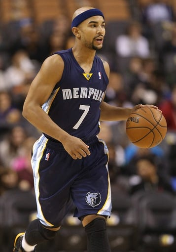 Oct 23, 2013; Toronto, Ontario, CAN; Memphis Grizzlies point guard Jerryd Bayless (7) dribbles against the Toronto Raptors at Air Canada Centre. The Raptors beat the Grizzlies 108-72. Mandatory Credit: Tom Szczerbowski-USA TODAY Sports