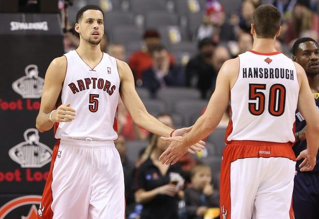 Oct 23, 2013; Toronto, Ontario, CAN; Toronto Raptors forward Austin Daye (5) celebrates a basket with forward Tyler Hansbrough (50) against the Memphis Grizzlies at Air Canada Centre. The Raptors beat the Grizzlies 108-72. Mandatory Credit: Tom Szczerbowski-USA TODAY Sports